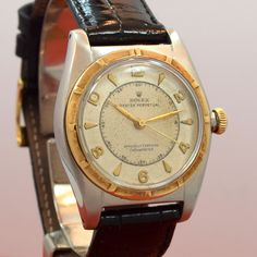 "secondtimearoundwatchco: "" This reference 5011 Rolex Bubbleback was manufactured in 1949. It sports a stainless steel, 33mm wide case, a 14K yellow gold, machined bezel, and a patinated silver dial with applied Arabic numerals. (Store Inventory #..."