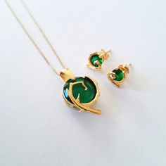 Kokiri Emerald 24k gold necklace spiritual stones inspired in The legend of Zelda series by geekandfreak on Etsy https://www.etsy.com/listing/242539140/kokiri-emerald-24k-gold-necklace
