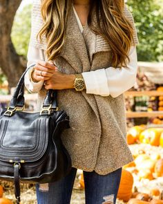 I love everything about this look - the color palette, the lines, the bag, and ESPECIALLY the vest!