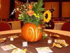 Love the initial carved in. Could even carve in the table #. Not crazy about the flower arrangement.