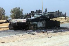 Iraq, May 2003: On the road to Baghdad, a US Marine Corps M1 Abrams Main Battle Tank lay destroyed after a firefight with Iraqi troops, during Operation IRAQI FREEDOM. Iraqi resistance was quickly subdued by the combination of lighting speed on the ground and complete US dominance in the air.