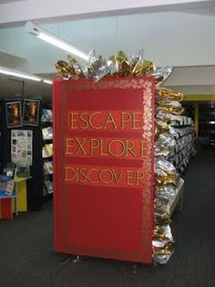 Escape.  Explore.  Discover.  End panel display. Library Displays