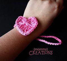 Heart Bracelet from http://www.vanillajoy.com/giveaway-2-crocheted-earwarmer-patterns-from-etsy-seller-yarnlovertn.html - really cute!