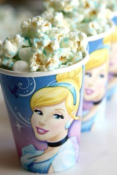 Cinderella Princess Popcorn made with popcorn, blue candy melts and marshmallows. See more Cinderella birthday party treats at CatchMyParty.com!