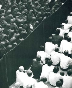 "SHIRIN NESHAT  (b. 1957)  ""FERVOR"" (CROWD FROM BACK, WOMAN LOOKING OVER  HER SHOULDER)"