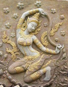 The Mother Earth Goddess of the Rigveda, Prithvi.  She became the witness of the Buddha against the demons, when he simply touched her. With a mere wringing of her hair came floods and earthquakes that terrify demons.  Prithvi is the sanskrit name for earth. She is also called Dhra, meaning that which holds everything.