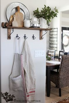 Shelving and hooks on The White Kitchen Wall - The Wood Grain Cottage
