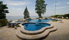 """Custom In-Ground Spa #1 (Long Island/NY):  This spa was part of a much larger project that includes a vanishing edge pool, swim up/walk up bar, and outdoor kitchen. The homeowner said she didn't need to travel anywhere. Her beautiful piece of Long Island has become to her more than a summer playground. """"It's a multi-seasonal resort worthy of today's presidents,"""" she said. """"It's all ours to enjoy and share.""""   http://www.longislandhottub.com/longisland_hot_tub_spa_blog/?p=2217  (Note: In…"""