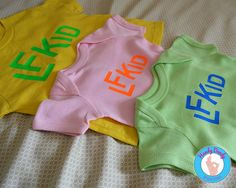 """These bright tees are exactly what your little Lawrencians need. Our made-to-order shirts feature bright lettering on onesie bodysuits or toddler t-shirts. The text reads LFKid.  All of our products are made to order on a professional heat press. If you'd like a different color combination (see image showing our options), include that info in the """"notes to seller"""" section when you are making your purchase, otherwise shirt will be created as pictured/selected.  Be sure to review the size…"""