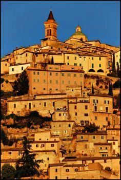 Italy - Umbria - Trevi  il sole al tramonto illumina le case di rosa
