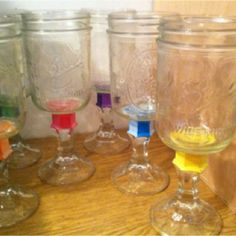 Mason jar wine glasses. Painted different colors so everyone knows whose is whose.