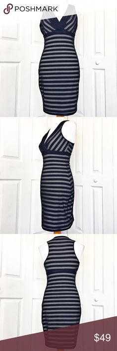 """Guess Dress Stunning dress that will take you from work to play.  Navy blue netting over a white bodice.  Has a neck line with a side zip and eye hook closure.  Material tag has been listed.  Measurements laid flat: bust 17"""", waist 13"""", hip 17"""", and length from top of shoulder to hem 35"""".  Measurements are approximate. Guess Dresses"""