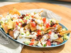 Greek Pita Nachos recipe from The Kitchen via Food Network