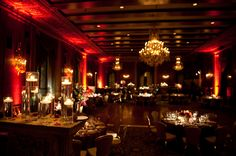 Elegant red wedding reception setup. *