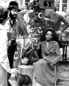Director Berry Gordy chats with his film crew on the set of Mahogany, while a pensive Diana Ross looks on (1975)    Diana Ross on the set of Mahogany with director Berry Gordy in 1975.
