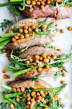 These Vegan Stuffed Sweet Potatoes are a healthy way to get dinner on the table fast and easy. Take advantage of spring vegetables! Meals like this are hearty and filling; so good even meat eaters will like them. Chickpeas, arugula, asparagus, and tahini-lemon dressing. A true vegetarian delight!