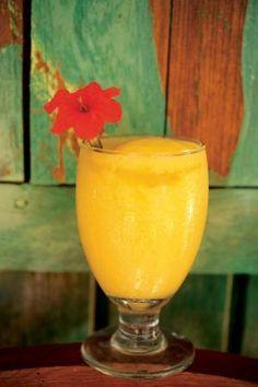Mango Margarita (1 oz. tequila 1 oz. triple sec 2 oz. simple syrup 2 1/2 oz. mango purée Juice from half a lemon)
