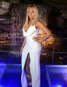 Ashanti wearing all white.