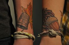 "Matching husband and wife tattoos.. Peter and Wendy's ""kisses"" to one another.. the thimble and the acorn"