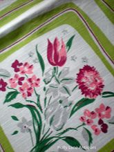 Beautiful Vintage Floral Print Tablecloth -  This lovely vintage tablecloth has a variety of pink flowers with green leaves each framed with a lime green border. These framed flowers encircle this cloth and there is also a ring of these flowers in the center.  $68