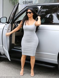 417f80da8dad Pregnant Kim Kardashian almost takes a tumble in high heels and tight grey  frock while shopping in Beverly Hills. Rodeo Drive