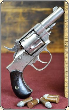 "FOREHAND AND WADSWORTH Double Action , .38 cal. rimfire, 2.3/8"" barrel, nickel finish, Rosewood grips. Produced in the early 1870s."