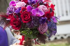 "Hot bouquet - Red and purple Anemone, lavender Phaleonopsis orchids, ""Moody Blues"" lavender rose, ""Black Magic"" lavender roses, Fiddlehead fern, red feathers, purple hydrangea - too much fun to list! - Design by J. Morris Flowers"