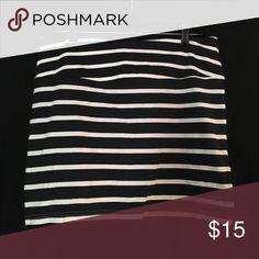 Black and white striped mini skirt Stretch skirt. Tag says medium but it's more like a large. Skirts Mini