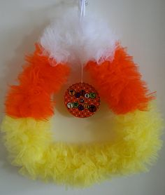Halloween Wreath Candy Corn Wreath Trick or Treat by LuceAccents, $30.00 OR you can bend a metal hanger to a triangle shape and but tulle when it goes on sale and diy
