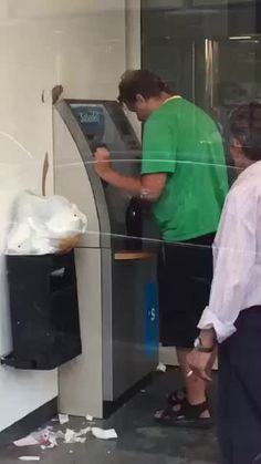 Man withdrawing money from an ATM in Russia.