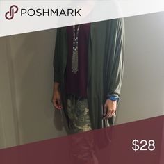 *NWT* Olive Cardigan This olive cardi is so perfect for fall! I have never worn it and it has the tags still on it! *boutique item* It is super comfy and adds a little extra to an outfit!! A great piece for layering!! It has slouchy sleeves that add to the relaxed/hip vibe! 😎 it's a little big in the shoulders for me, which is why I'm selling it but if you like things super flowy this is a great addition to your closet! Sweaters Cardigans