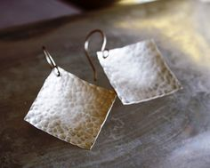"Sterling Silver Square earrings are unique and light weight! Hammered texture is polished to a high shine. square is 1/2"" 1.25"" long"