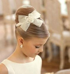 Beautiful, classy and sleek flower girl hair.