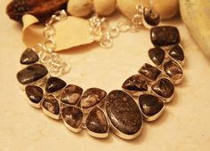 Solid .925 Sterling Silver setting encase the superb natural silhouette of these fossilized Turtella, forming a stunning necklace. Turtella jasper is a concretion of fossilized shells. The stone has a