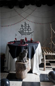 Marlen Kärema //  festive party decor // pirate party, created with black balloons as well as red and black tape.