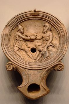 Roman oil lamp with scene of Ulysses Intoxicating Polyphemos 1-100 CE -  Terracotta