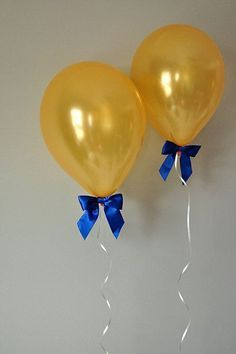 Balloons with ribbon , beauty and the beast birthday party .