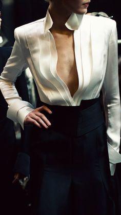 Donna Karan I'd button up a bit, Love it otherwise.