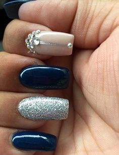 Navy blue, silver, and nude acrylic nails.