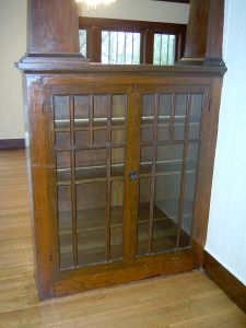 1922 Craftsman bungalow: In the dining room, built-in cabinets make up the base of the colonnade and retain their original multi-pane doors.