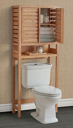 While most homeowners make sure that their kitchen has plenty of storage, they often neglect their bathrooms. There is a lot of unused space in the ba... | Spa-Like Vibe #overthetoiletstorage #overthetoilet #decoratedlife #bathroom #bathroomstorage Toilet Storage, Small Bathroom Storage, Bathroom Design Small, Bathroom Interior Design, Diy Furniture Building, Pallet Furniture, Furniture Design, Wood Shop Projects, Bathroom Furniture
