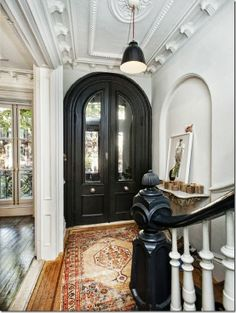 Love the black door and complementing black banister // via Decor Happy