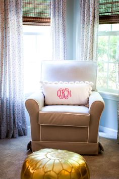 Pompom monogram pillow in the glider = nursery perfection!