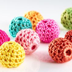 Crochet Beads. Each bead has a delicate hand crocheted covering. Versatile enough to use as buttons, embellishing garments or for making a piece of jewellery. The bead size is 16mm with a 3mm threading hole. £2.58 for a pack of 10.