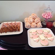 Pretzel rods covered in pink chocolate, pink popcorn balls,, and pink gum balls, and cookies. Can you find the theme? #sweetTdesigns3