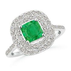 Dreams of Glory Ring - Double halo framing the dazzling cushion shaped emerald with diamonds on the shank for added sparkle - in 14K Gold or Platinum #angara #haloengagementrings