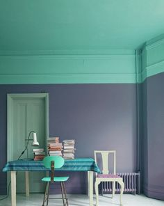 This purple and teal combo is pretty bold. Not sure I'd ever do it, but I like the large band around the top of the room that matches the ceiling.