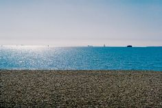 Southsea beach.  The rule of three has been clearly applied here horizontally. The horizontal thirds are clearly seperated by the stones, the water and then the sky. I could use something like this for my own photography.