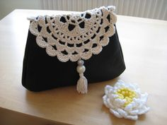 Doily flap on leather clutch bag :)
