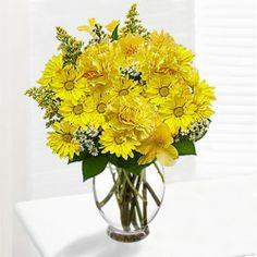 Send this cheerful sunflower to your friend with the arrangement of yellow gerbera daisies, alstroemeria, daisy poms, solidago, monte casino and salal in a glass vase. Send Flowers Online, Online Florist, Mothers Day Flowers, Flower Delivery, Fresh Flowers, House Warming, Flower Arrangements, Glass Vase, Bouquet